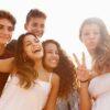 Group,Of,Teenage,Friends,Dancing,And,Taking,Selfie